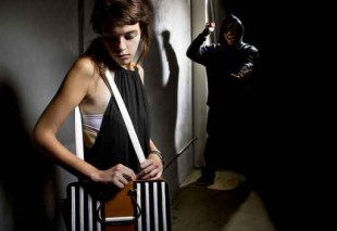 criminal stalking a woman alone in a dark street alley